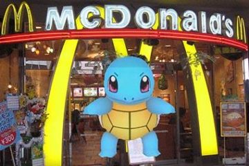 Pokemon Go character stands in front of a McDonald's arches in virtual game.