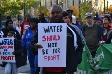 Protester supporting public water