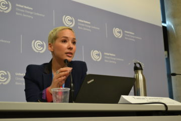 Corporate Accountability's International Policy Director, Tamar Lawrence-Samuel, calls on governments to remove Big Polluters from the policy process during the U.N. climate talks.