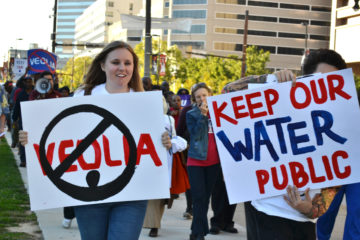 Lauren DeRusha Corporate Accountability at Baltimore water privatization rally.