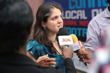 Senior Program Director Shayda Naficy speaks to the press in Lagos, Nigeria about how corporations that privatize water undermine the human right to water. CREDIT: Babawale Obayanju