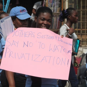 Veronica Nwanya, an organizer with our longtime ally Environmental Rights Action, leads a women's march for water justice in Lagos, Nigeria, as part of our joint campaign for a strong, public water system in the city. CREDIT: Environmental Rights Action