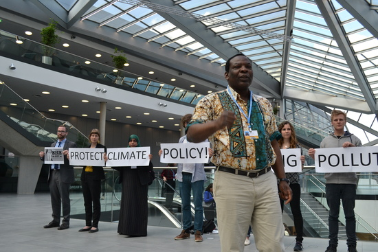 Godwin Ojo of Environmental Rights Action/Friends of the Earth Nigeria delivering a call to the U.N. in front of an action at this week's U.N. climate treaty meetings. Photo credit: Corporate Accountability International