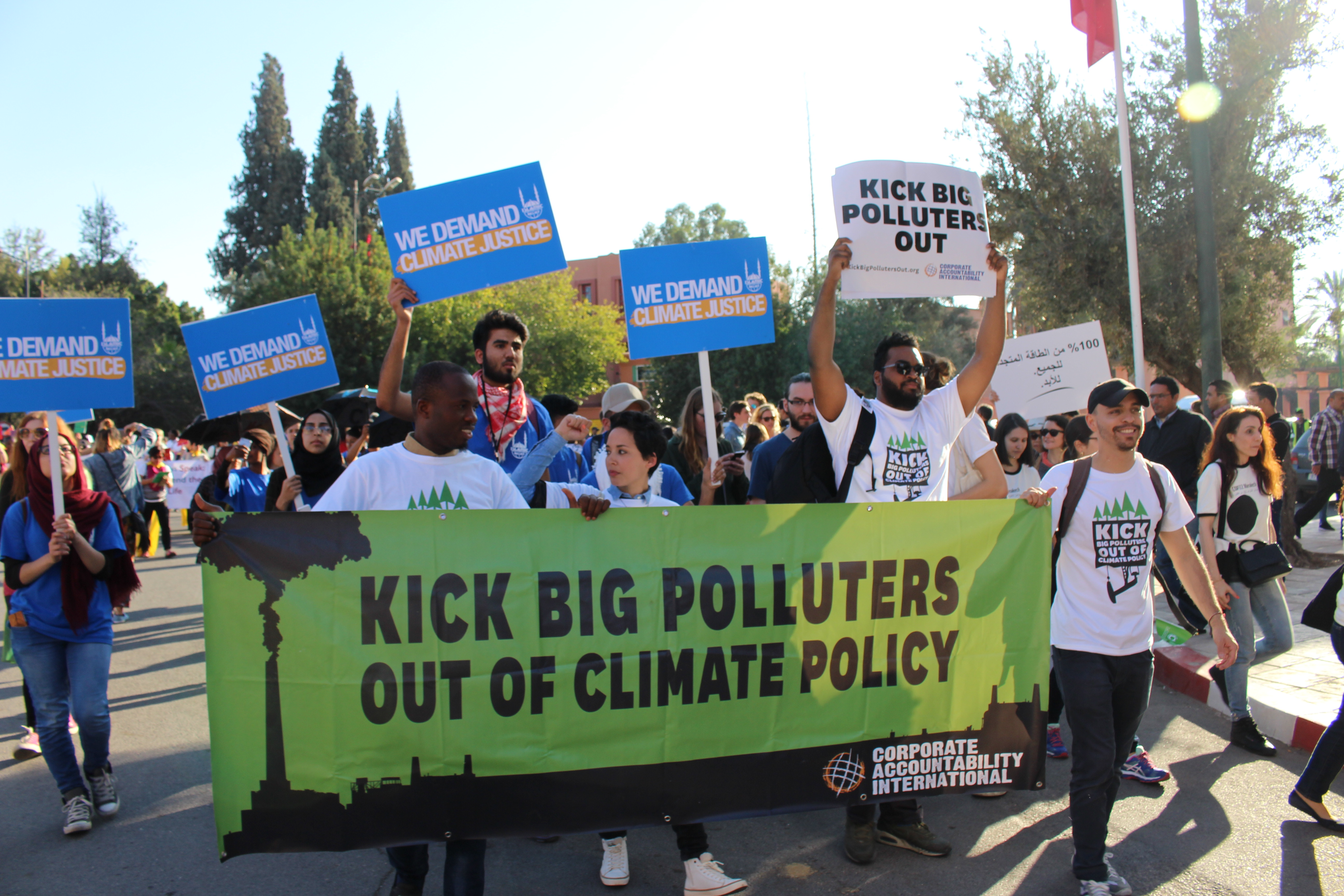 Our team— pictured here at the 2016 U.N. climate talks in Marrakech, Morocco— dares to demand just climate policy free of Big Polluters' influence.