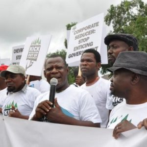 Environmental Rights Action/Friends of the Earth, Nigeria tells Chevron to stop manipulating climate talks. Photo: Corporate Accountability International