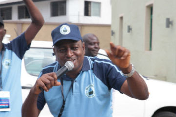 Akinbode Oluwafeme at a rally for Our Water, Our Right coalition.