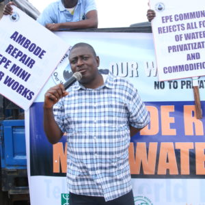 Deputy Executive Director Akinbode Oluwafemi of Environmental Rights Action/Friends of the Earth Nigeria, a Corporate Accountability board member, speaks at a massive rally for the human right to water in Lagos.