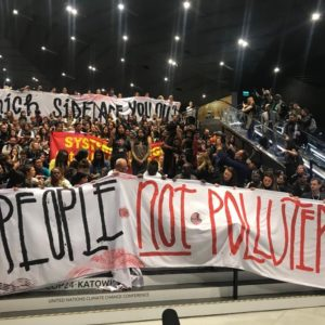 Hundreds call for just climate policy at sit in at the end of COP24.