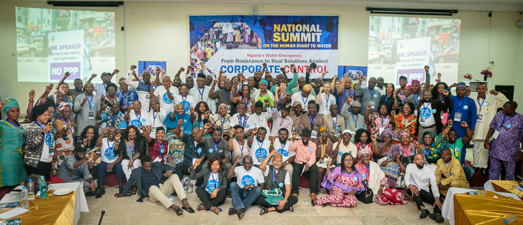 Nearly 150 attendees stood together at the National Water Summit in Abuja, Nigeria. CREDIT: BABAWALE OBAYANJU