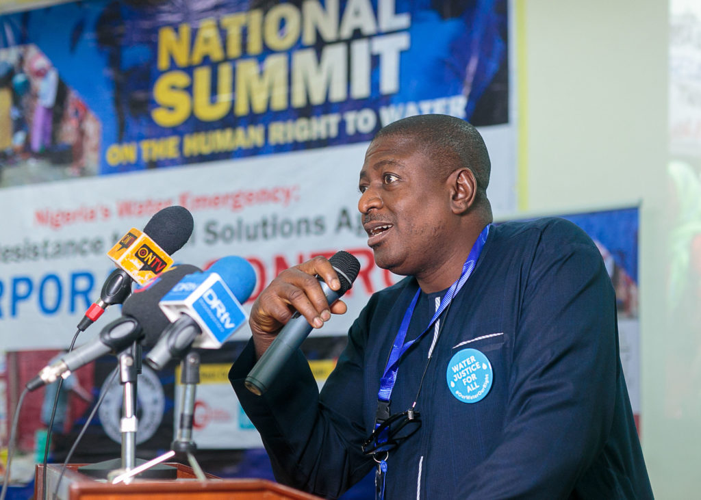 Bode Oluwafemi, deputy director of Environmental Rights Action/Friends of Nigeria, addresses attendees at the National Water Summit in Abuja, Nigeria. CREDIT: BABAWALE OBAYANJU