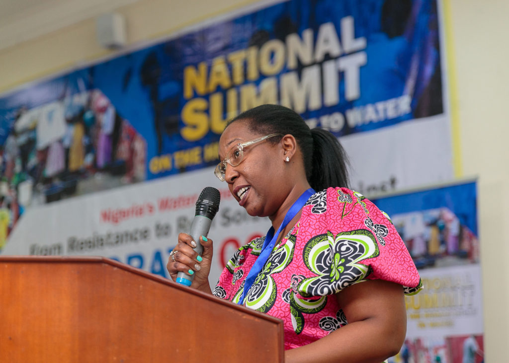 Gina Luster, activist with Flint Rising from Flint, Michigan, speaks to attendees at the National Water Summit in Abuja, Nigeria. CREDIT: BABAWALE OBAYANJU