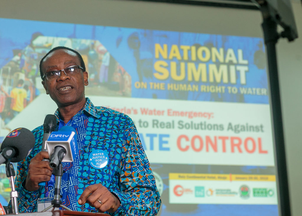 Nnimmo Bassey, board chair of Enviromental Rights Action/Friends of the Earth Nigeria, speaks to attendees at the National Water Summit in Abuja, Nigeria. CREDIT: BABAWALE OBAYANJU
