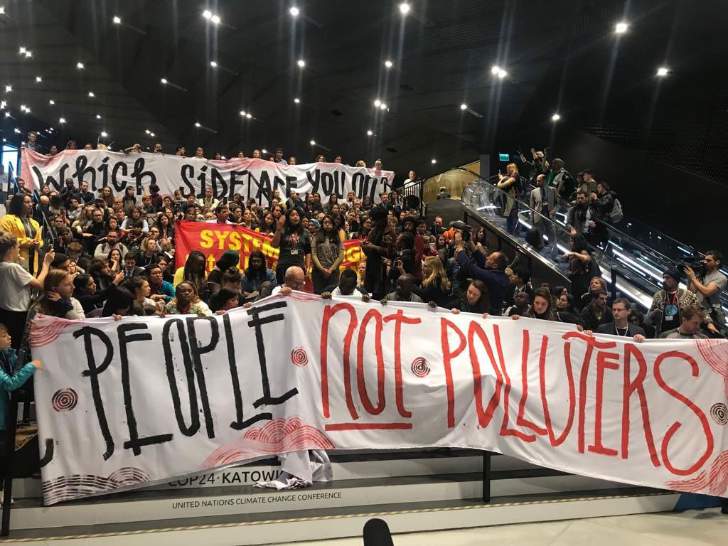 Hundreds of activists challenge governments to put people over polluters' profits on the last day of the COP24 climate treaty negotiations in Poland in December 2018. The movement to kick Big Polluters out has grown mightier than ever.