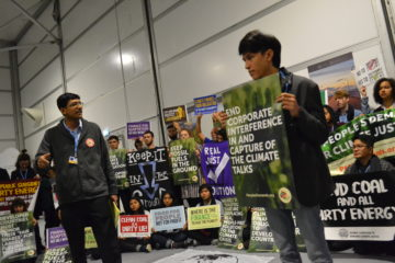 Sriram Madhusoodanan introduces the People's Demands at COP24 rally.