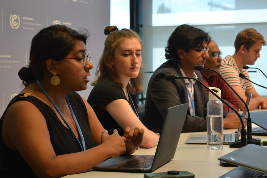 Panelists speak at a press conference on Big Polluters' conflicting interests at the global climate treaty talks.