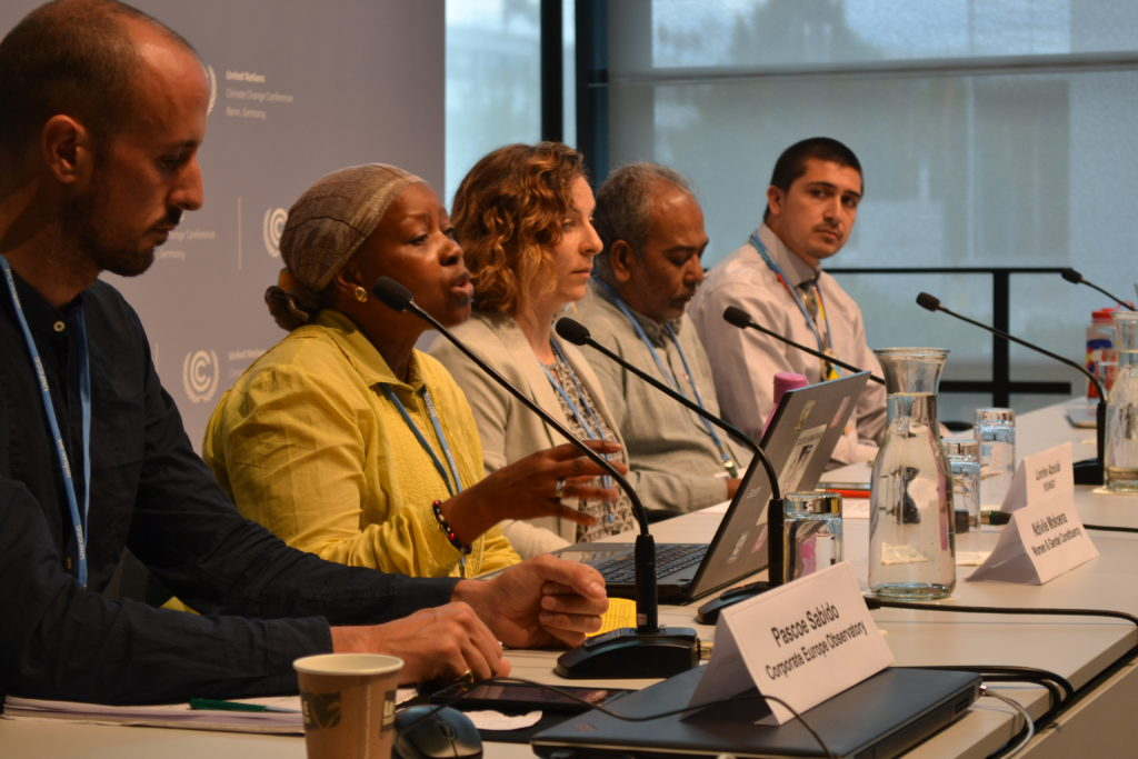 Left to right: Pascoe Sabido, Corporate Europe Observatory, moderates a press conference on Big Polluters and conflicts of interests featuring Ndivile Mokoena representing the Women & Gender constituency; Lorine Azoulai, Youth constituency; Souparna Lahiri, Demand Climate Justice; and Michael Charles, Indigenous Peoples' Caucus and member of the Navajo Nation.