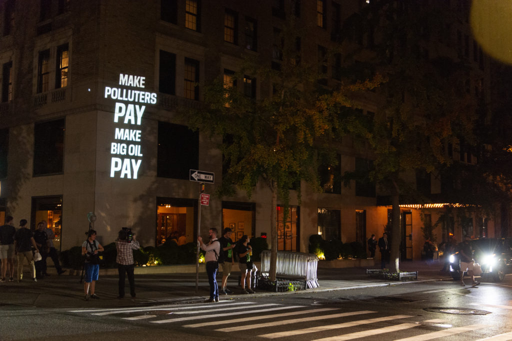 Make Big Polluters pay projected on the Gramercy Park Hotel during UN climate week in New York City