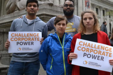 Corporate Accountability organizers stand up to PMI at its annual shareholders meeting, and hold signs outside the NYC public library.