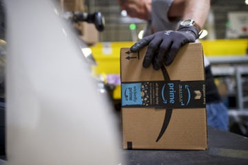 Amazon worker holding a box
