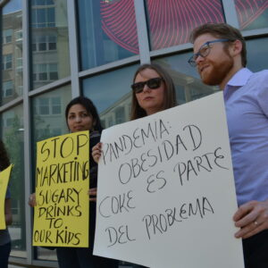 Organizers protest Coca-Cola's marketing practices and political influence outside of the corporation's headquarters.