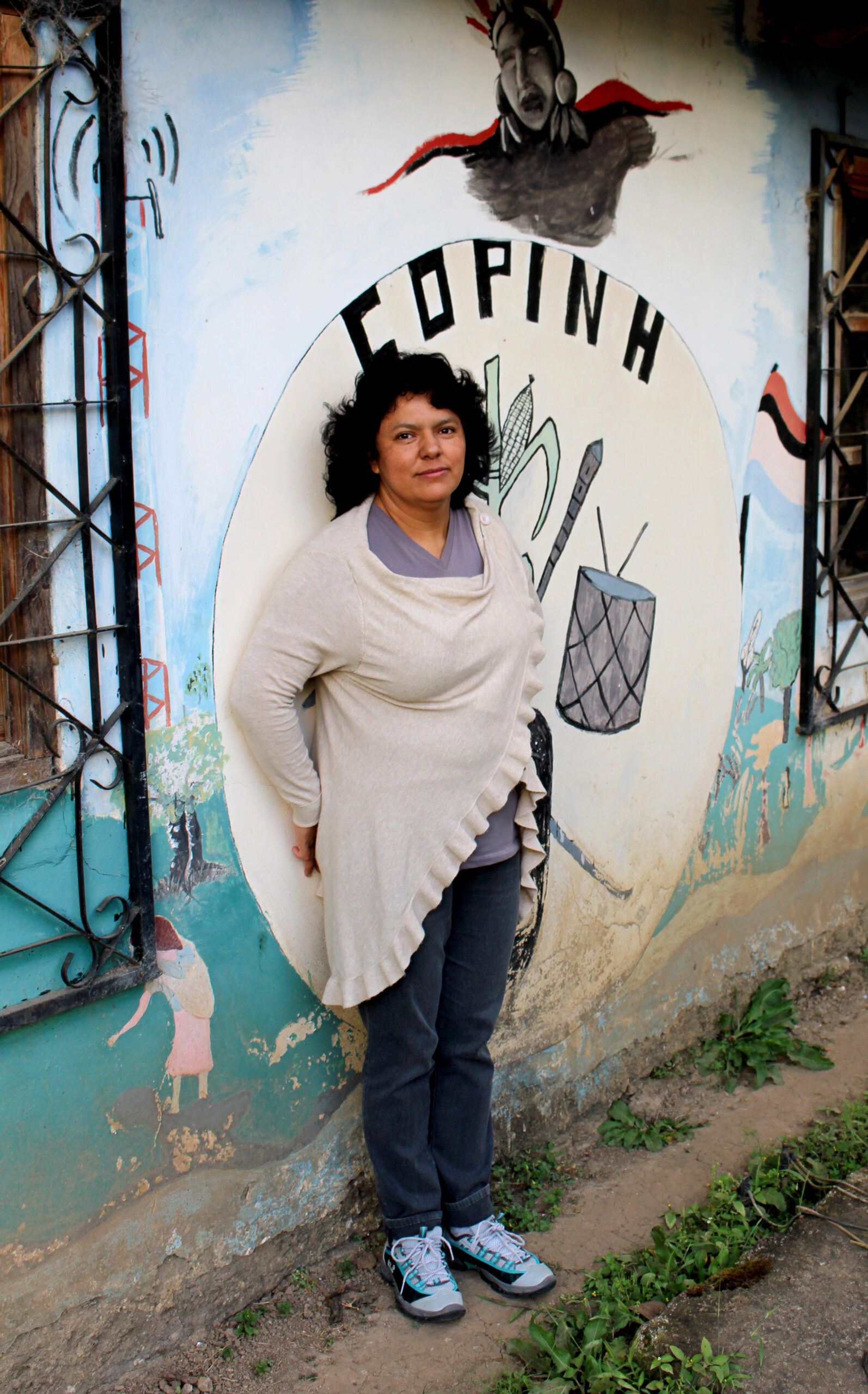 Women challenging corporate power: Berta Caceres stands at the COPINH (the Council of Popular and Indigenous Organizations of Honduras) offices in La Esperanza, Intibucá, Honduras.